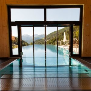 Underwater swimming pool door, Almwellness-Resort Tuffbad